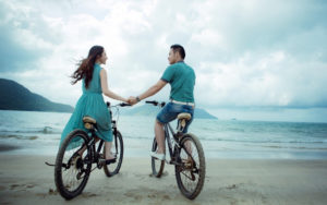couple-bicycle-riding-on-beach-hd-wallpaper-75
